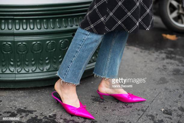 A guest poses wearing Balenciaga jumper and shoes and a Chanel bag after the Chloe show at the Maison Chloe during Paris Fashion Week Womenswear SS18...
