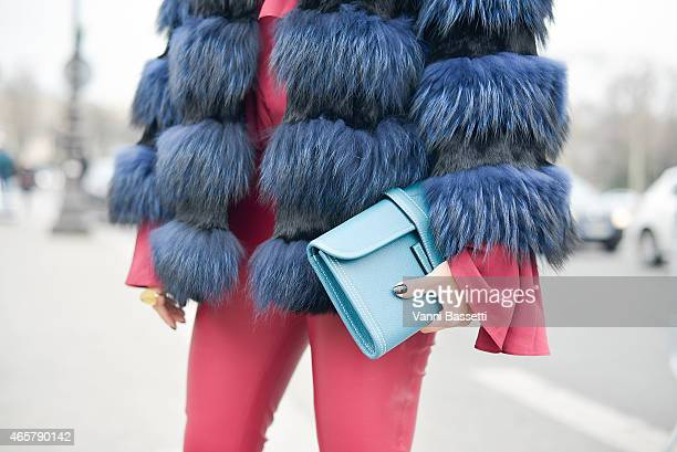 A guest poses wearing Balmain pants and Hermes bag on Day 8 of Paris Fashion Week Womenswear FW15 on March 10 2015 in Paris France