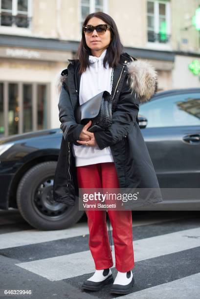 A guest poses wearing Celine boots before the Koche show at the Folies Bergere during Paris Fashion Week Womenswear FW 17/18 on February 28 2017 in...
