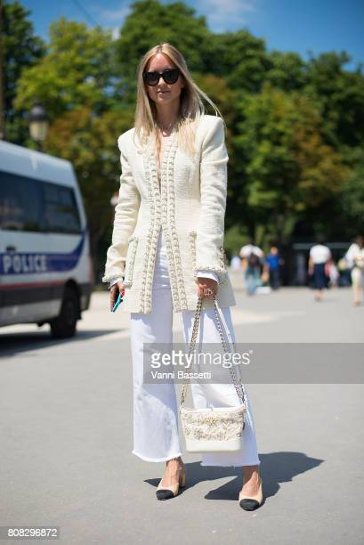 A guest poses wearing Chanel after the Chanel show at the Grand Palais during Paris Fashion Week Haute Couture FW 17/18 on July 4 2017 in Paris France