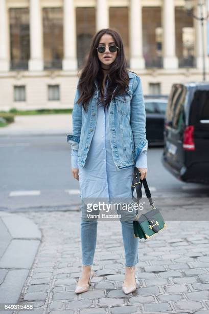 A guest poses wearing Dior shoes and a Prada bag after the Shatzy Chen show at the Grand Palais during Paris Fashion Week Womenswear FW 17/18 on...