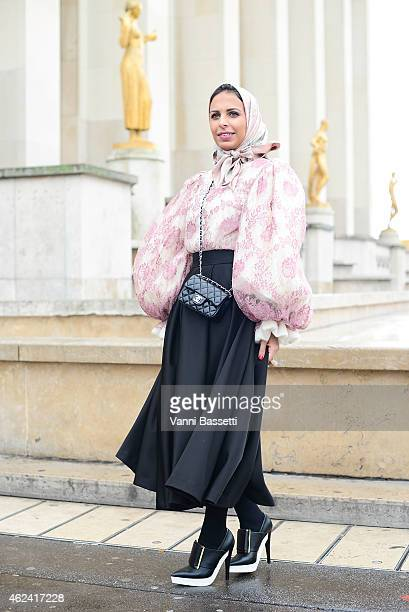 A guest poses wearing Dolce and Gabbana top H and M skirt Chanel bag and Stella Mccartney shoes during day 4 of Paris Haute Couture Spring Summer...