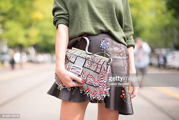A guest poses wearing Fendi after the Fendi show during Milan Fashion Week Spring/Summer 2017 on September 22 2016 in Milan Italy