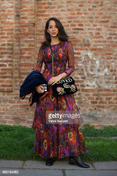 A guest poses wearing Gucci after the Alberta Ferretti show during Milan Fashion Week Spring/Summer 2018 on September 20 2017 in Milan Italy
