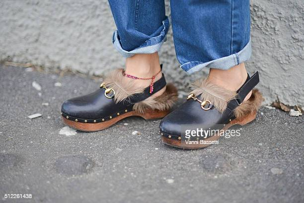 A guest poses wearing Gucci shoes before the Emilio Pucci show during the Milan Fashion Week Fall/Winter 2016/17 on February 25 2016 in Milan Italy