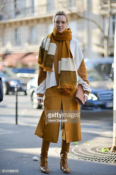 A guest poses wearing Hermes after the Hermes show during Paris Fashion Week FW 16/17 on March 7 2016 in Paris France