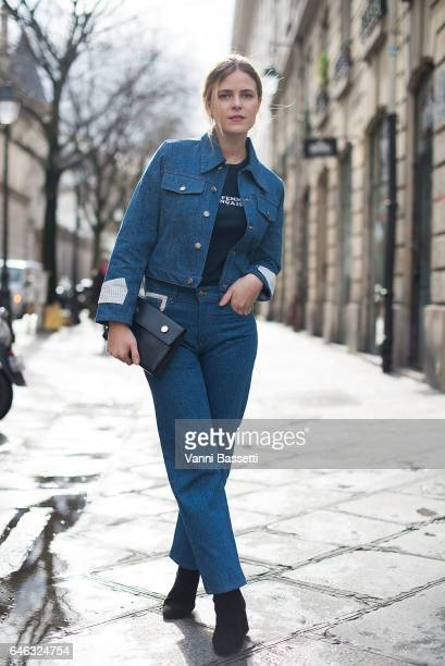 A guest poses wearing Journe total look before the Journe show at the Musee de la Chasse during Paris Fashion Week Womenswear FW 17/18 on February 28...