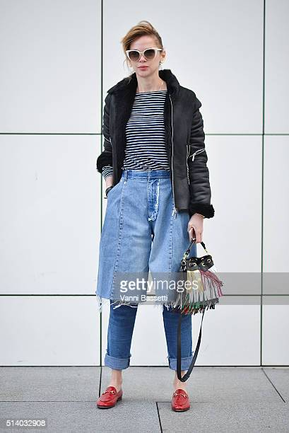 A guest poses wearing Ksenia Schnaider trousers before the Balenciaga show during Paris Fashion Week FW 16/17 on March 6 2016 in Paris France