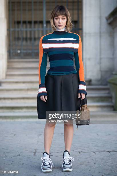 A guest poses wearing Louis Vuitton before the Louis Vuitton show at the Pyramide du Louvre during Paris Fashion Week Womenswear FW 18/19 on March 6...