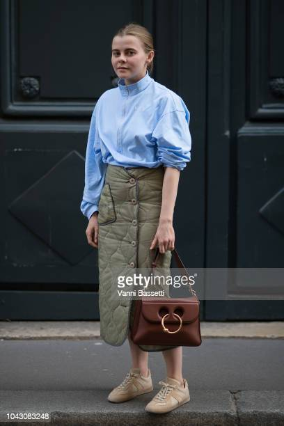 A guest poses wearing Margiela shoes and a JW Anderson bag after the Comme des Garcons show at the Ecole des Beaux Arts during Paris Fashion Week...