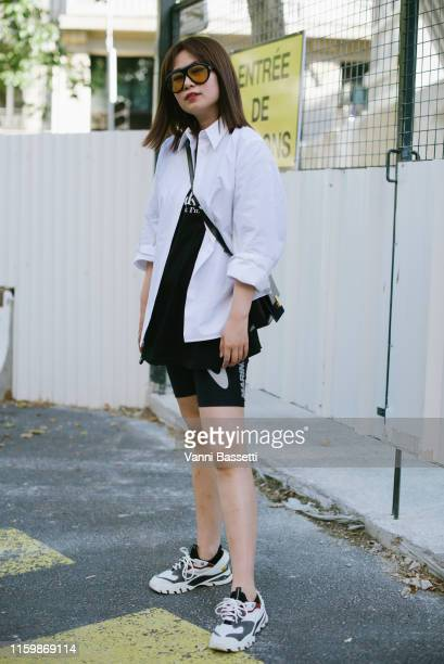 A guest poses wearing Marine Serre shorts and Gucci sunglasses after the Valentino Show during Paris Fashion Week Haute Couture Fall/Winter 2019/2020...