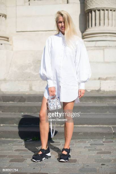 A guest poses wearing Marni shoes and a Dior bag after the Ulyana Sergeenko show at the Lycee Henri IV during Paris Fashion Week Haute Couture FW...