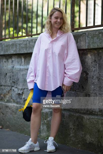 A guest poses wearing Martin Rose shorts and Heron Preston bag after the Y Project show during Paris Fashion Week Menswear SS19 on June 20 2018 in...