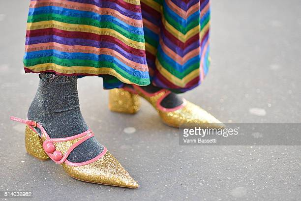 A guest poses wearing Miu Miu shoes after the John Galliano show at the Lycee Carnot during Paris Fashion Week FW 16/17 on March 6 2016 in Paris...
