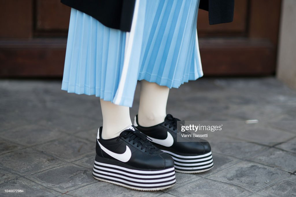 new product 23d78 ce7e7 A guest poses wearing Nike Cortez X Comme des Garcons shoes ...