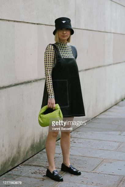 Guest poses wearing Prada bucket hat and loafers after the Kenzo show during Paris Fashion Week - Womenswear Spring summer 2021 on September 30, 2020...