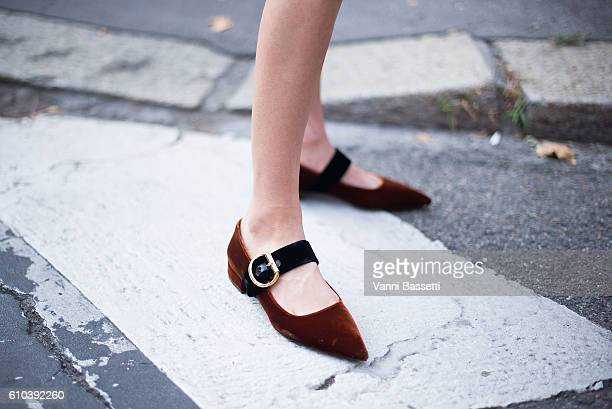 A guest poses wearing Prada shoes after the Marni show during Milan Fashion Week Spring/Summer 2017 on September 25 2016 in Milan Italy