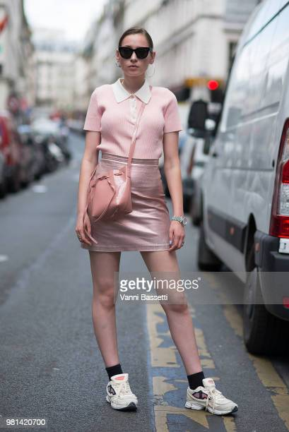 Guest poses wearing Raf Simons sneakers and Celine sunglasses before the Hed Mayner show during Paris Fashion Week Menswear SS19 on June 22, 2018 in...