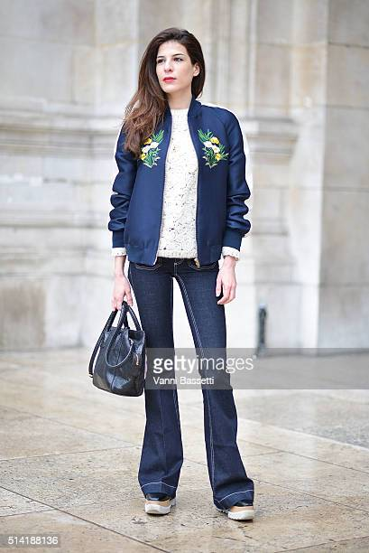 A guest poses wearing Stella McCartney before the Stella McCartney show at the Opera Garnier during Paris Fashion Week FW 16/17 on March 7 2016 in...