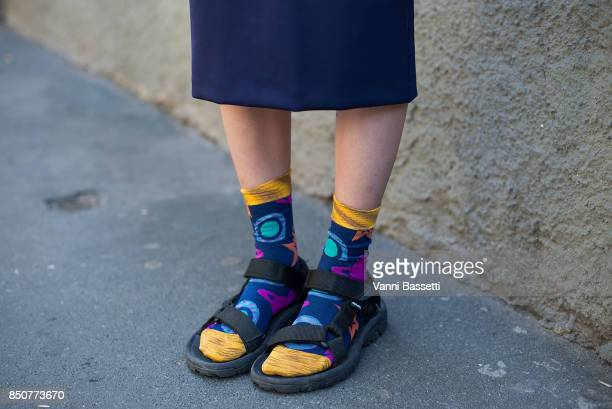 A guest poses wearing Teva sandals after the Fendi show during Milan Fashion Week Spring/Summer 2018 on September 21 2017 in Milan Italy