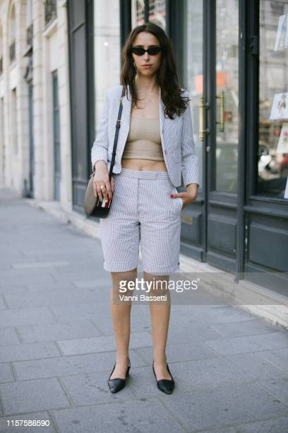 A guest poses wearing Thom Browne after the Thom Browne show at the Ecole des Beaux Arts during Paris Fashion Week Menswear Spring/Summer 2020 on...
