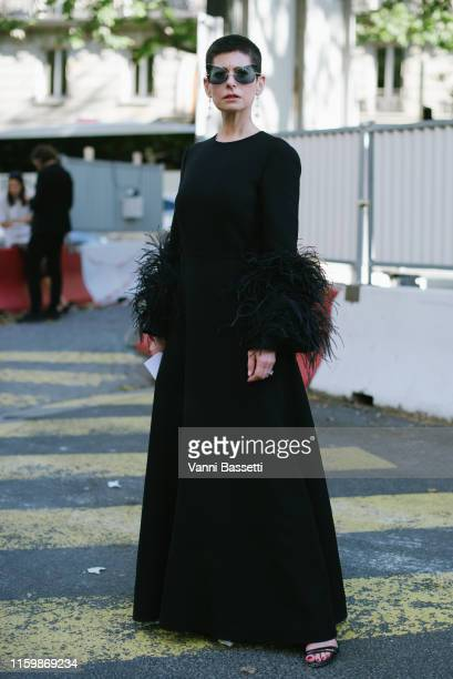 Guest poses wearing Valentino after the Valentino Show during Paris Fashion Week - Haute Couture Fall/Winter 2019/2020 on July 03, 2019 in Paris,...