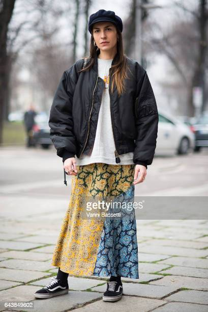 A guest poses wearing Vans shoes and a bomber jacket before the Wunderkind show during Milan Fashion Week Fall/Winter 2017/18 on February 22 2017 in...