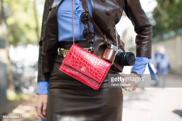 A guest poses with a Chanel bag after the Dior show at the Musee Rodin during Paris Fashion Week Womenswear SS18 on September 26 2017 in Paris France