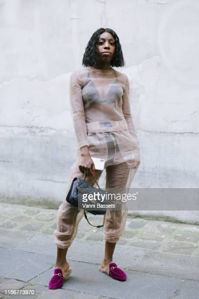 Guest poses with a Chanel bag after the Sankuanz show during Paris Fashion Week - Menswear Spring Summer 2020 on June 18, 2019 in Paris, France.