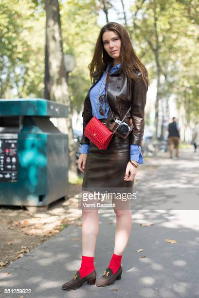 A guest poses with a Chanel bag and Hermes shoes after the Dior show at the Musee Rodin during Paris Fashion Week Womenswear SS18 on September 26...