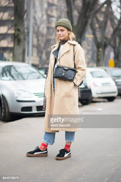 A guest poses with a Chanel bag and Puma shoes after the Fendi show during Milan Fashion Week Fall/Winter 2017/18 on February 23 2017 in Milan Italy