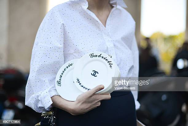 Guest poses with a Chanel clutch before the Rochas show at the Palais de Tokyo during Paris Fashion Week SS16 on September 30, 2015 in Paris, France.