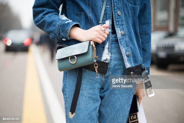 A guest poses with a Chloe bag after the Fendi show during Milan Fashion Week Fall/Winter 2017/18 on February 23 2017 in Milan Italy