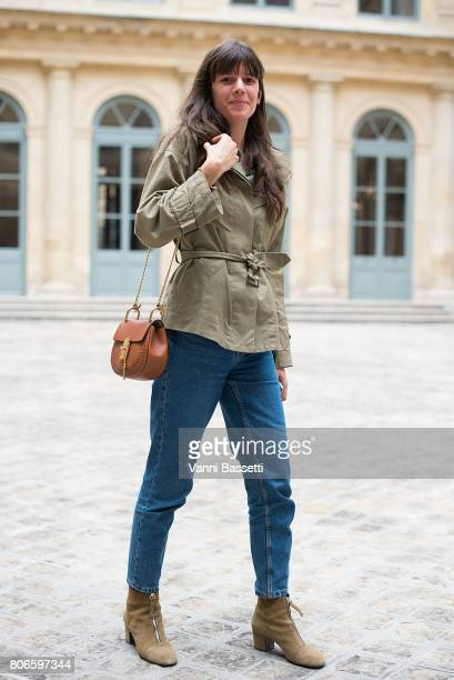 A guest poses with a Chloe bag after the Schiaparelli show at Place Vendome during Paris Fashion Week Haute Couture FW 17/18 on July 3 2017 in Paris...