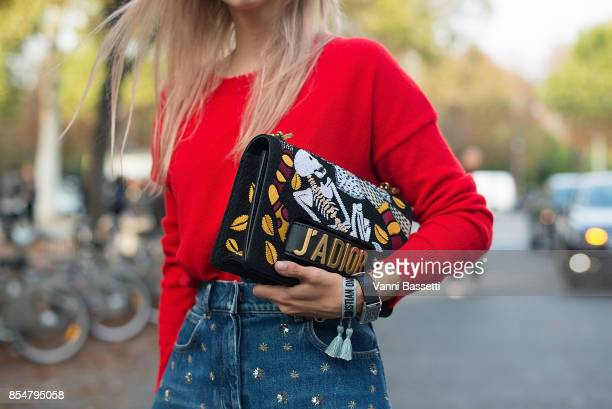 A guest poses with a Dior bag after the Rochas show at the Pavillion Ledoyen during paris Fashion week Womenswear SS18 on September 27 2017 in Paris...