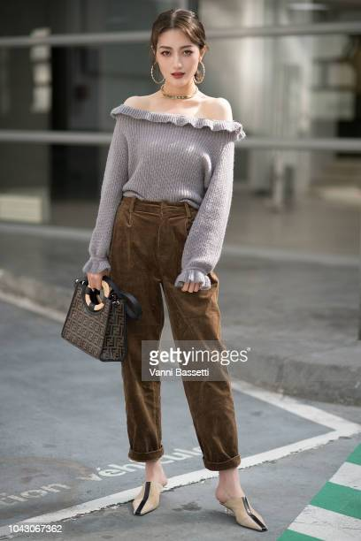 A guest poses with a Fendi bag after the Vivienne Westwood show at the Garage Amelot during Paris Fashion Week SS19 Womenswear on September 29 2018...
