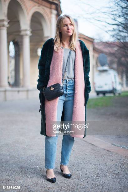 A guest poses with a Gucci bag before the Alberta Ferretti show during Milan Fashion Week Fall/Winter 2017/18 on February 22 2017 in Milan Italy