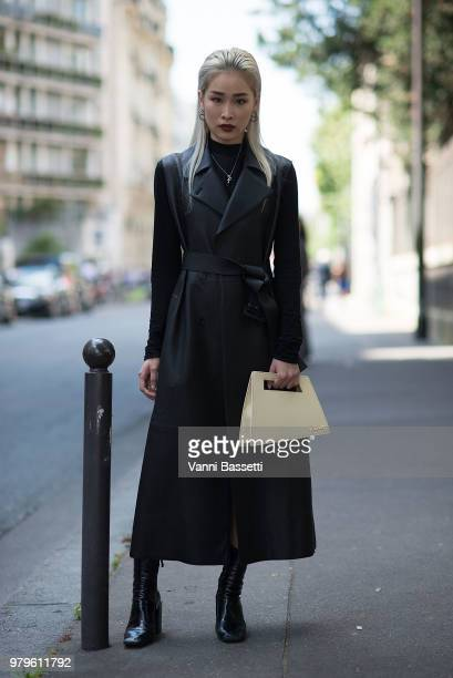 A guest poses with a Jacquemus bag after the Y Project show during Paris Fashion Week Menswear SS19 on June 20 2018 in Paris France Photo by Vanni...