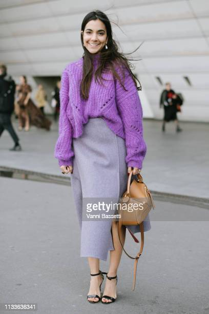 A guest poses with a Loewe bag after the Giambattista Valli show at the Palais des Congres during Paris Fashion Week Womenswear Fall Winter 2019/2020...