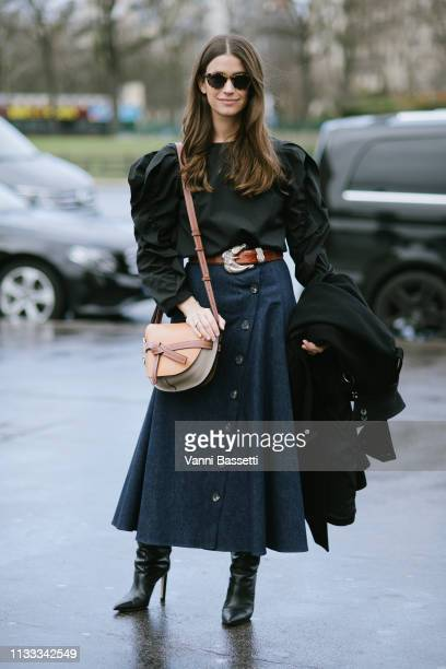 A guest poses with a Loewe bag after the Haider Ackermann show at the Theatre National de Chaillot during Paris Fashion Week Womenswear Fall Winter...