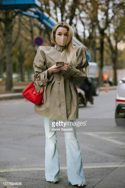 Guest poses with a Prada bag after the Acne Studios show at the Grand Palais during Paris Fashion Week - Womenswear Spring summer 2021 on September...