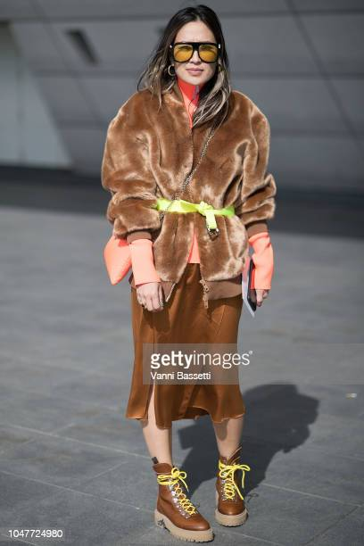A guest poses with a Prada fluorescent bag after the Giambattista Valli show at the Palais des Congres during Paris Fashion Week SS19 Womenswear on...