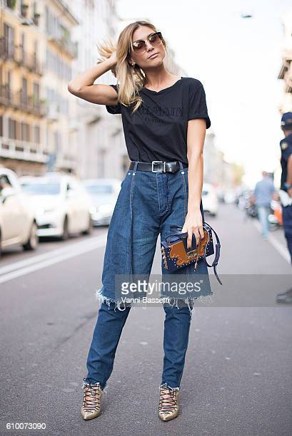 A guest poses with a Salar bag and Balmain tshirt after the Les Copains show during Milan Fashion Week Spring/Summer 2017 on September 22 2016 in...