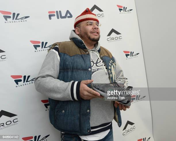 A guest poses with a sneaker at the Launch of the FILA Mindblower PopUp Powered by Ciroc on April 19 2018 in New York City