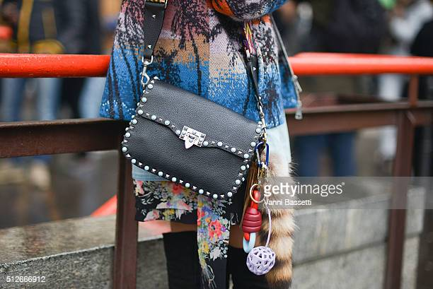 A guest poses with a Valentino bag and Loewe keychain before the Jil Sander show during the Milan Fashion Week Fall/Winter 2016/17 on February 27...