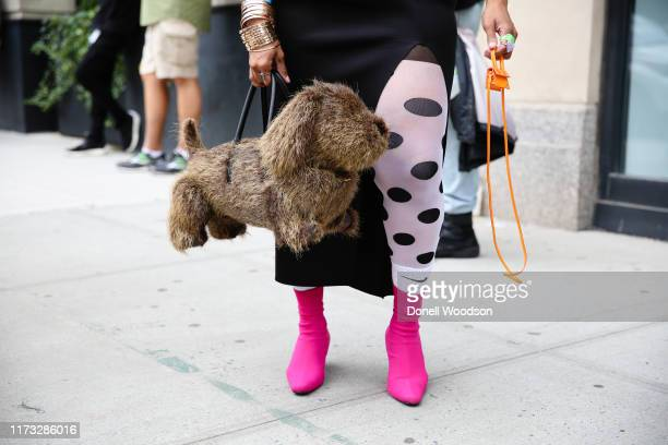 Guest poses with accessories outside of Spring Studios during New York Fashion Week on September 08, 2019 in New York City.