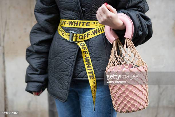 A guest poses with an Off White industrial belt and a Mansur Gavriel bag after the Olivier Theyskens show during Paris Fashion Week Womenswear FW...