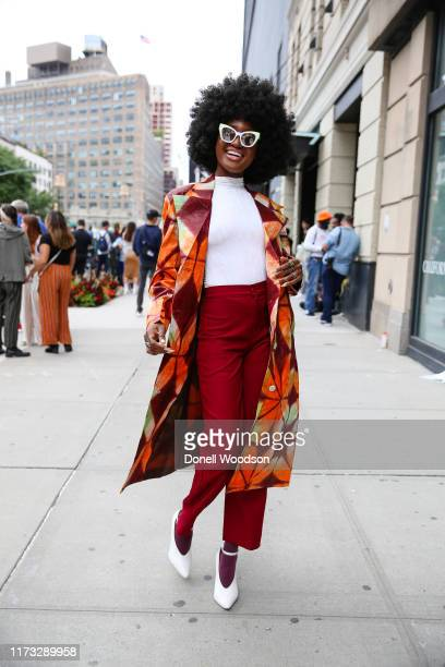 Guest poses with white shirt and a colorful blazer and white sunglasses outside of Spring Studios during New York Fashion Week on September 08, 2019...