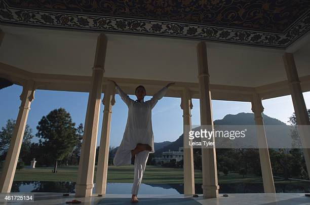 A guest practises yoga asanas in the yoga pavillion at Ananda in the Himalayas a luxury destination spa resort specialized in ayurveda This 5000year...