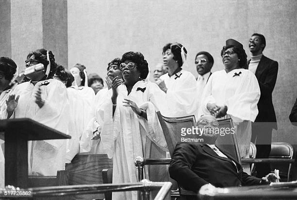 Guest preacher Rev Martin Luther King Sr listens as a choir group sings a hymn at the Canaan Baptist Church in Harlem